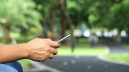 Close up of a man using mobile smart phone outdoor Footage