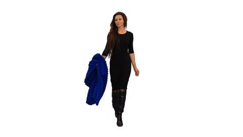 Front view of an elegant woman in black dress walking, 4k alpha channel Footage