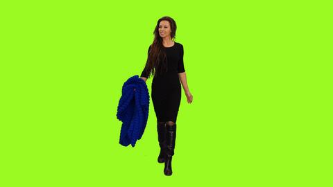 Front view of an elegant woman in black dress walking, Full HD alpha channel Footage