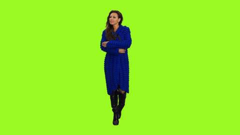 Beautiful woman in blue cardigan is walking and smiling, alpha channel Footage