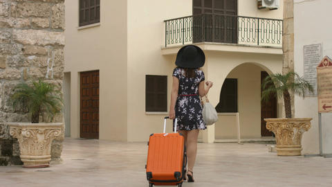 Beautiful young female leaving for airport, vacation in exotic country abroad Footage