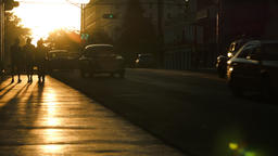Pedestrians and cars in the sunset glow silhouettes in Havana Footage