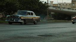 Vintage cars on a busy old Havana street Footage