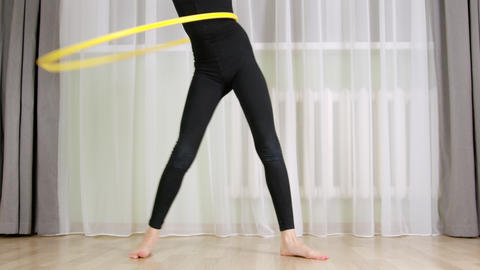 Cropped partial view of girl training with hula hoop GIF