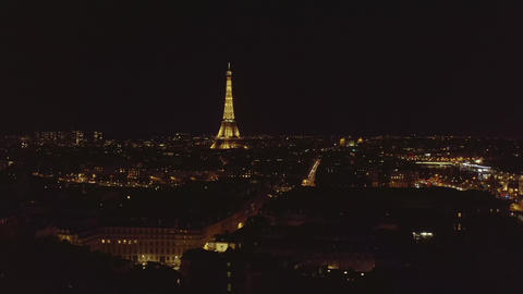 AERIAL: View over Paris, France at Night with View on Eiffel Tower, Tour Eiffel Live Action