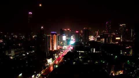 Cars moving fast over the streets of night illuminated Bangkok timelapse Live Action
