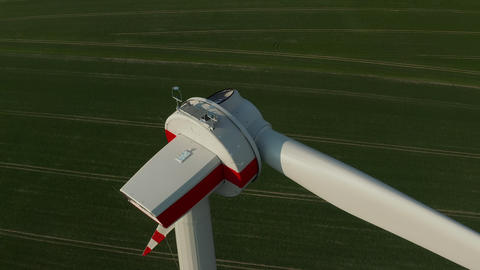 AERIAL: Close up Circling Wind Turbine under construction being build on rich Live Action
