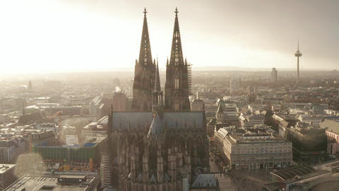 AERIAL: Towards Cologne Cathedral and TV Tower in beautiful hazy Sunlight with Live Action