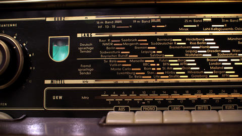 Close up display vintage radio with frequencies of European cities and countries GIF