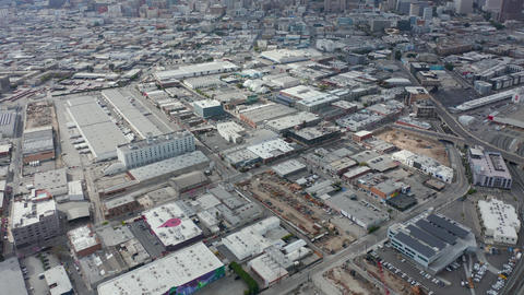 AERIAL: Warehouse District in Los Angeles slow Tilt up revealing Downtown LA Live Action