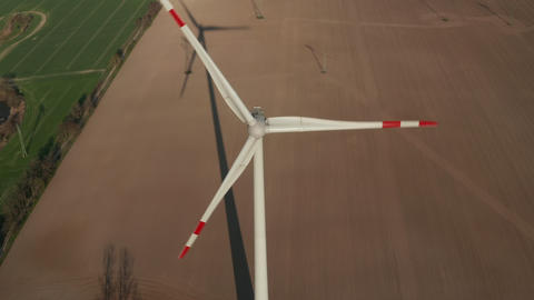 AERIAL: Close up shot of wind Turbine, Mill rotating by the force of the Wind Live Action
