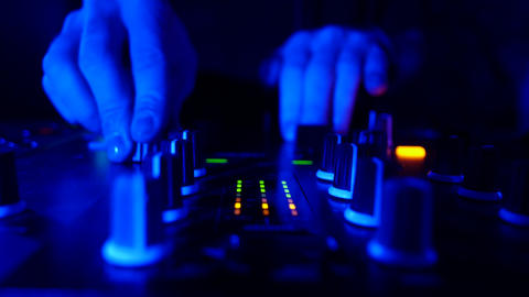 Dj's hands mixing tracks on a dj mixer close-up - nightlife clubbing concept Live Action
