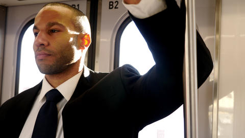 Businessman is a suit riding the train to work Live Action
