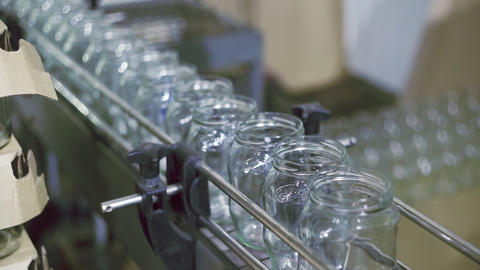 Empty Glass cans on automatic line for processing vegetables Live Action