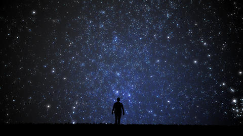 Man looking at the stars. Alone man looking at starry sky. Night sky Live Action