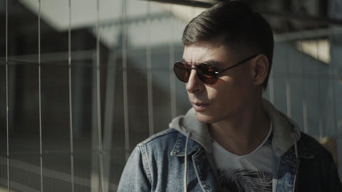 Portrait of handsome stylish hipster with sunglasses. Handsome and cool guy Live Action