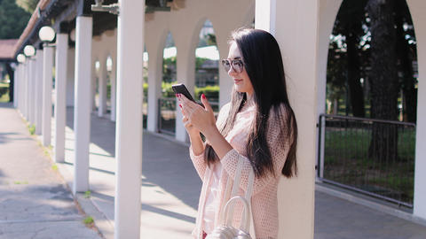 happy woman using phone and taking selfie photo outdoors ライブ動画
