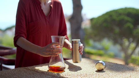Making speciality coffee at home. Filter coffee on the terrace with a view. Girl Live Action