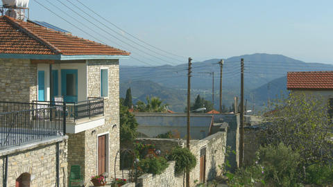Masonry holiday house and street, beautiful mountains in background, landscape Footage