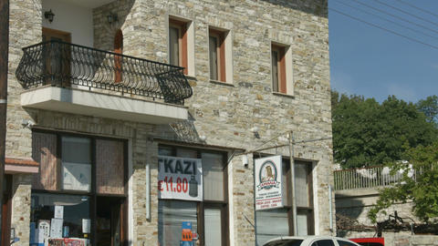Vertical panorama of masonry building with small convenience store, street view Footage