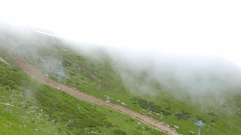 The cable chair lift raises in clouds. Ridge Aibga. Sochi, Russia Footage