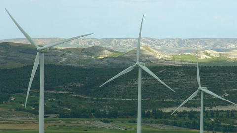 Alternative energy generation, nature conservation. Wind turbines, green hills Footage