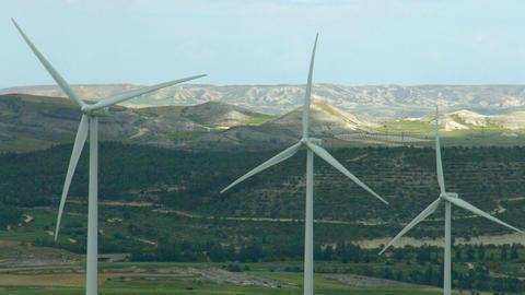 Alternative energy generation, nature conservation. Wind turbines, green hills Footage
