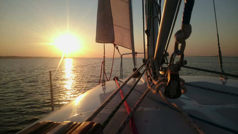 Beautiful sunset over sea, view from sailboat, yachting, luxury hobby, vacation Footage