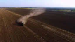 Cultivation soil: farm tractor plowing cropped field harvesting HD aerial video Footage
