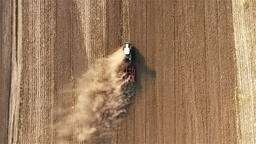 Cultivation soil: tractor plowing cropped field harvesting HD video aerial top Footage