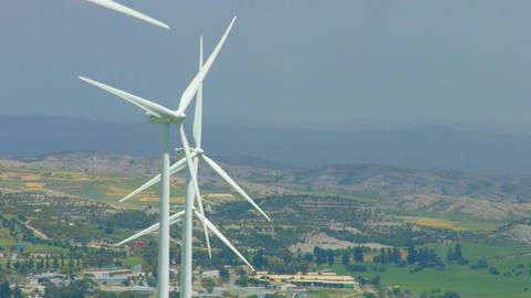 Wind turbine propellers spinning, gray rainy horizon, cloudy sky, green energy Footage