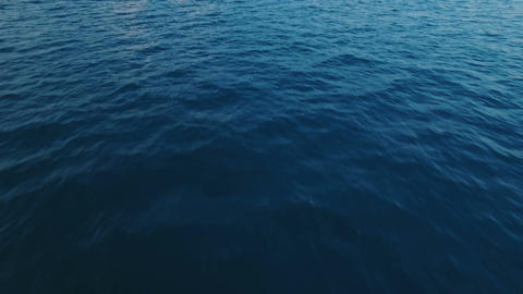 Aerial Wide Shot of Moving Over Ocean Waves Footage