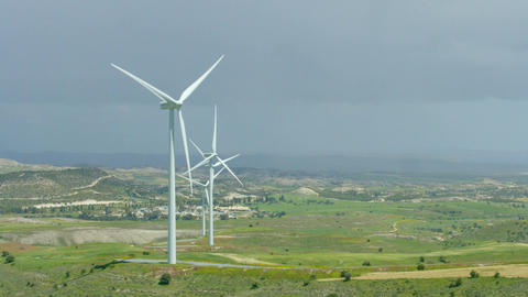 Amazing panorama of beautiful landscape, wind turbines rotating, green hills Footage