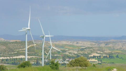 Amazing panorama of green rural landscape, mountains on horizon, wind farm Footage