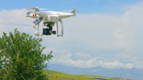 Modern drone flying in sky, professional video filming, innovation technology Footage