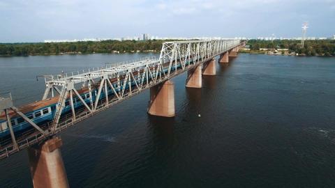 Aerial View of Train Moving on Railway Bridge ビデオ