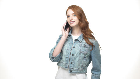 Young caucasian woman talking on phone and smiling. Beautiful caucasian young Live Action