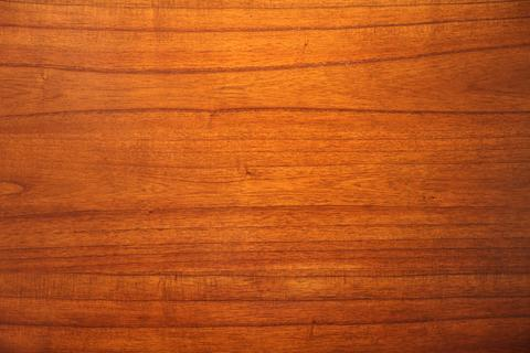 Red wood texture grain natural wooden paneling surface Photo