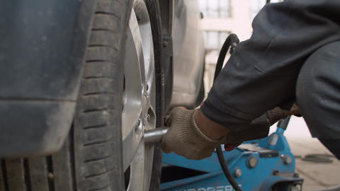 Car wheel replacement in a car service Live Action