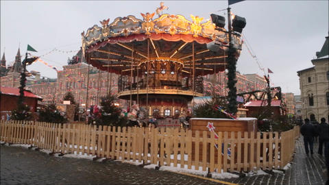 Moscow Kremlin Red Square with people enjoy life and children go in carousel Live Action