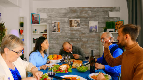 Zoom in shot of family enjoying a good red wine Live Action