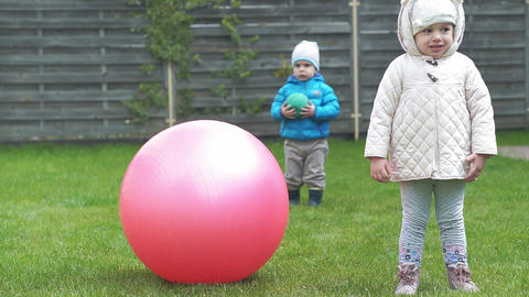 Childhood, leisure, game, yard, spring concept - three young children play in Live Action