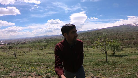 man and view of spring nature GIF