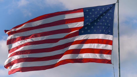 Large American flag gently waving in the wind Live Action