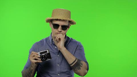 Portrait of man tourist photographer getting a great idea. Chroma key Live Action