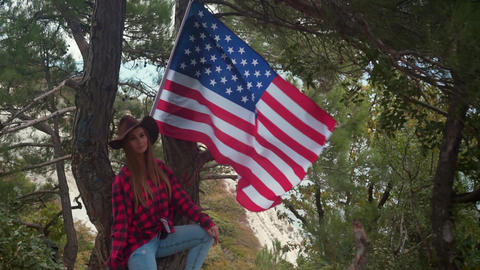 Girl on nature with american flag. The concept of American patriotism Live Action