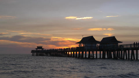 Dark silhouette of a sea pier during sunset Live Action