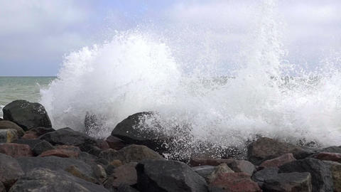 Spray of the Surf on the Rocky Seashore. Slow Motion Footage