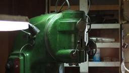 Vintage green lathe machine in workshop Footage