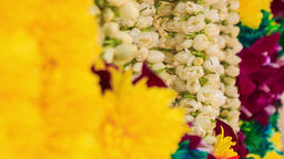 Closeup Garlands of Yellow White Red Flowers in Batu Caves Footage